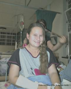 A family member brushes Cassandra's hair while she was still in hospital following her stroke,
