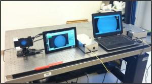 The high-resolution microendoscope was first developed using a laptop computer (right), then a tablet (middle), but to make the devise even more portable researchers have developed a new version that works with a cellphone (left).