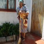 Mofolo North senior citizen Rachel Vuyelwa Mcetywa sweeping her house.