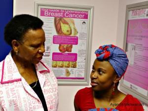 Sister Catherine Mashao takes Maggie Phago through a breast examination
