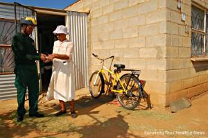 In the North West, Community Healthcare Worker Fikile Mokabane tests a pensioner's blood sugar in the NHI pilot site.