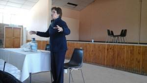 Nurse Van Bergen talking at a healthcare community committee meeting recently.