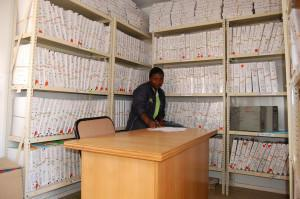 Research student, Idah Rikhotso in the file room at the Tswaka local research centre in Jouberton. Photo by Itumeleng Tau.