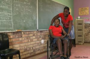 Makhosi Ndabambi is helped by her friend in class