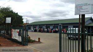 Patients wait outside Tlamelong Clinic