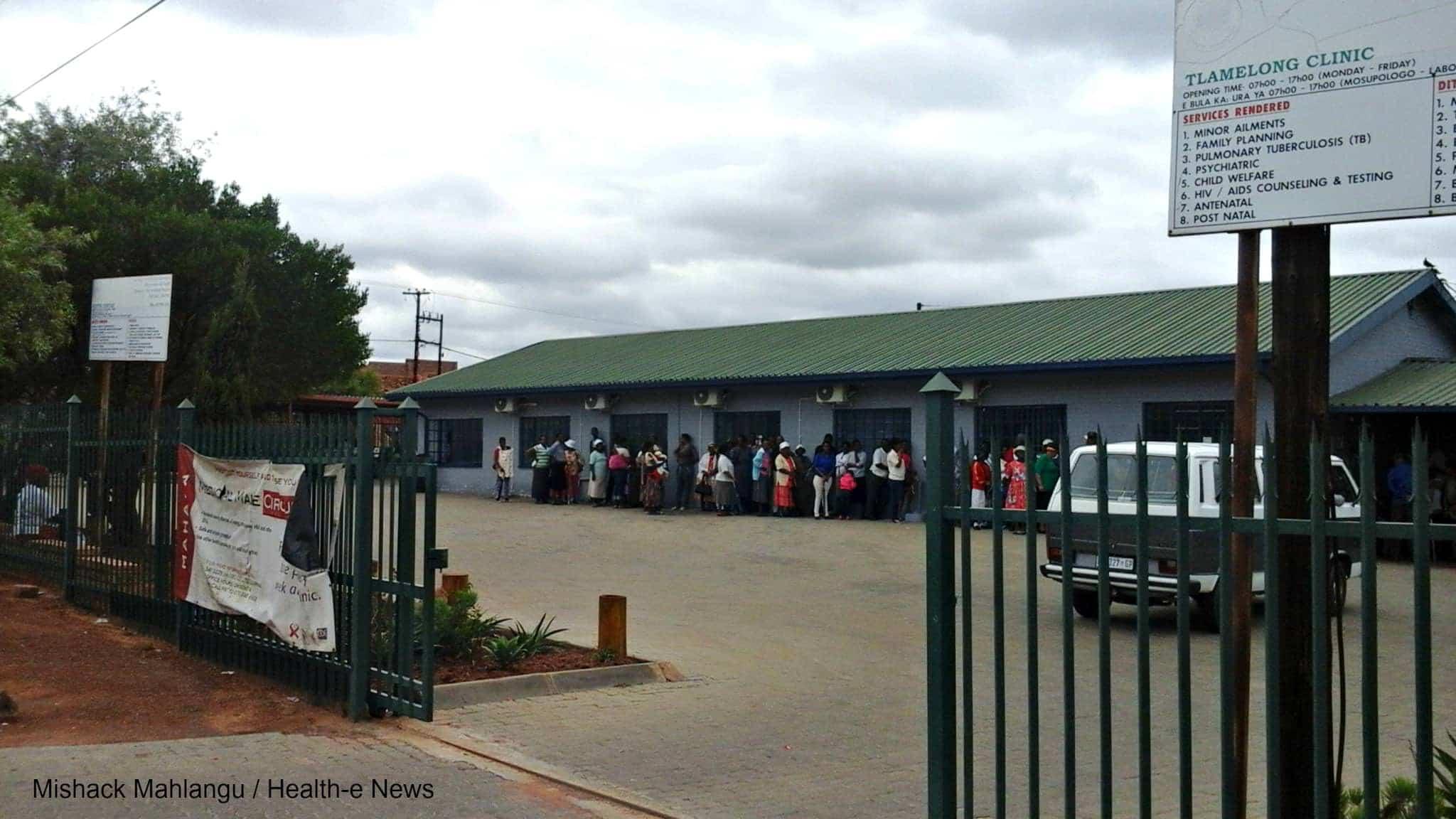 Patients wait outside Tlamelong Clinic