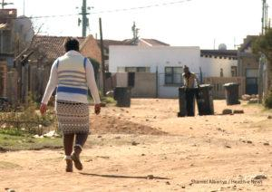 Sophia Molefe, who refuses to take her Schizophrenia medication, walks through the streets of Snake Park, Soweto.