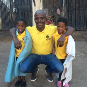 Thabo Ramastokotla with the kids they have placed in schools