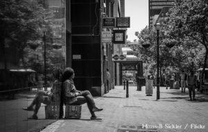 A woman sits on a crate in Cape Town's CBD. Credit: Hans-B. Sickler/ Flickr