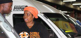 Sonke Gender Justice's Nonhlanhla Skosana speaks to a taxi driver about preventing gender-based violence. Credit: Amy Green
