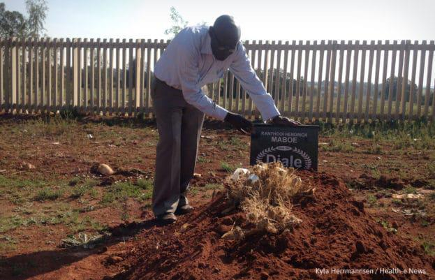 Reverend Joseph Maboe visits the grave of his son, Billy, a former Life Esidimeni patient.