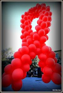A giant red ribbon made from balloons to celebrate World Aids Day in 2012. Credit: Bill Morrow/ Flickr