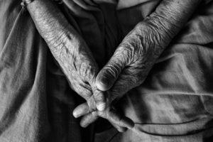 Clasped hands of an elderly person. Credit: Vinoth Chander/ Flickr