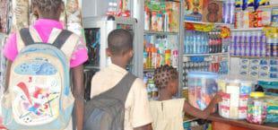 Benin (Cotonou) School kids in a convenience store where cigarettes are on  sale