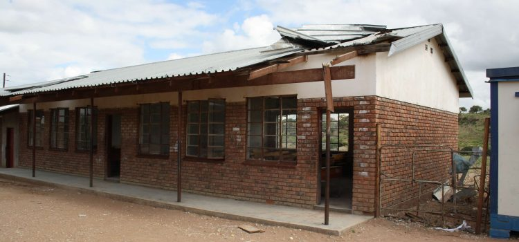 Five years later, parts of school still roof-less