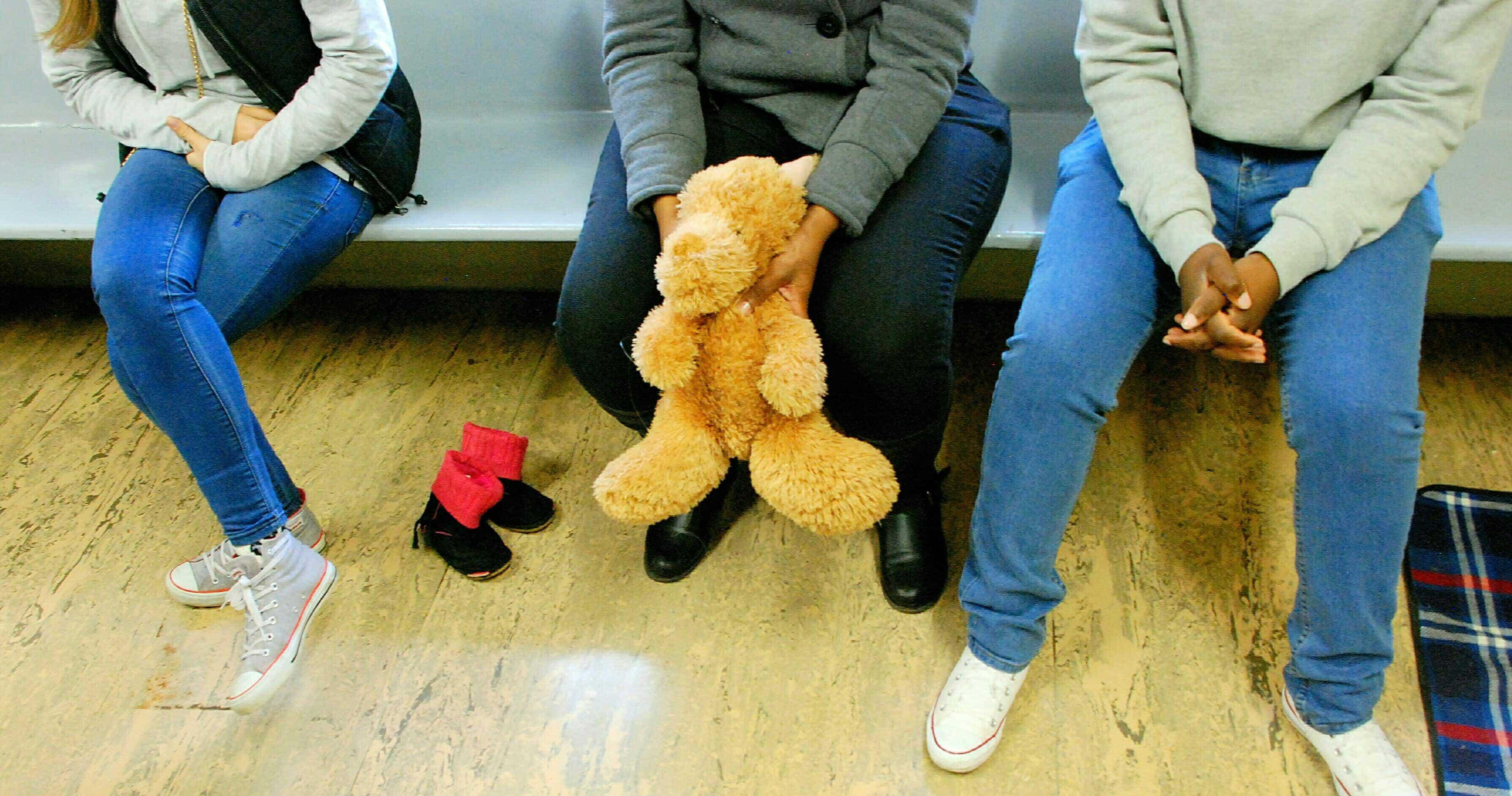 Woman holding teddy bear
