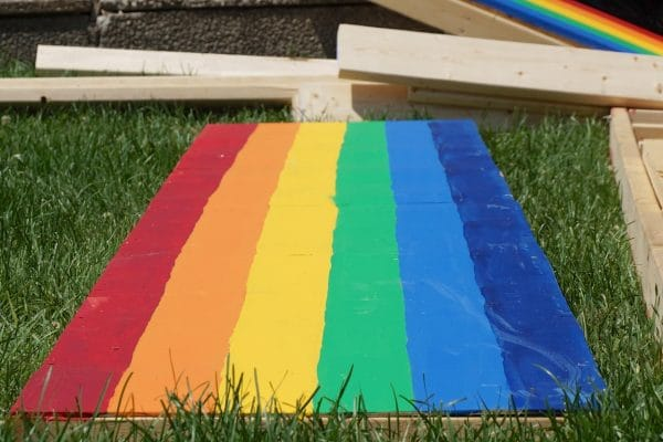 LGBTQI colours painted on a lawn surface