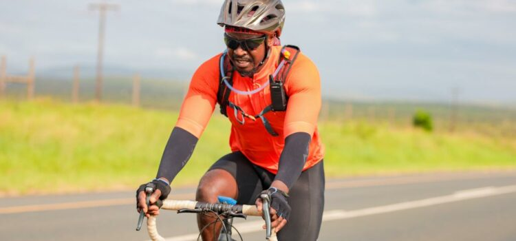 A father is cycling across the country to raise awareness about good parenting and gender-based violence