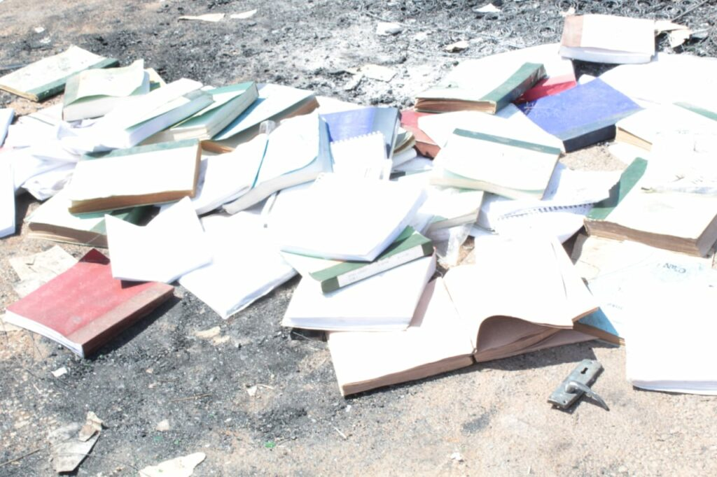 Books lie scattered on a road in Limpopo after community protests terrible conditions at school for the blind