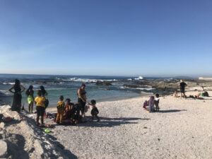Women and children reclining on a Sea Point Beach in Cape Town South Africa without masks as Covid-19 intensifies.