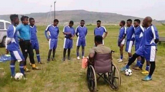 A paraplegic soccer coach in action