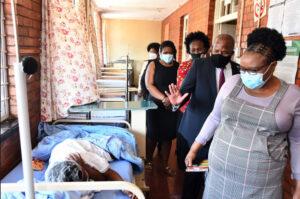 Jackson Mthembu waving at sick woman in hospital during Covid-19 pandemic