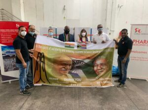 A group of diplomats from India and South Africa holding a banner dipicting South African and Indian relationship