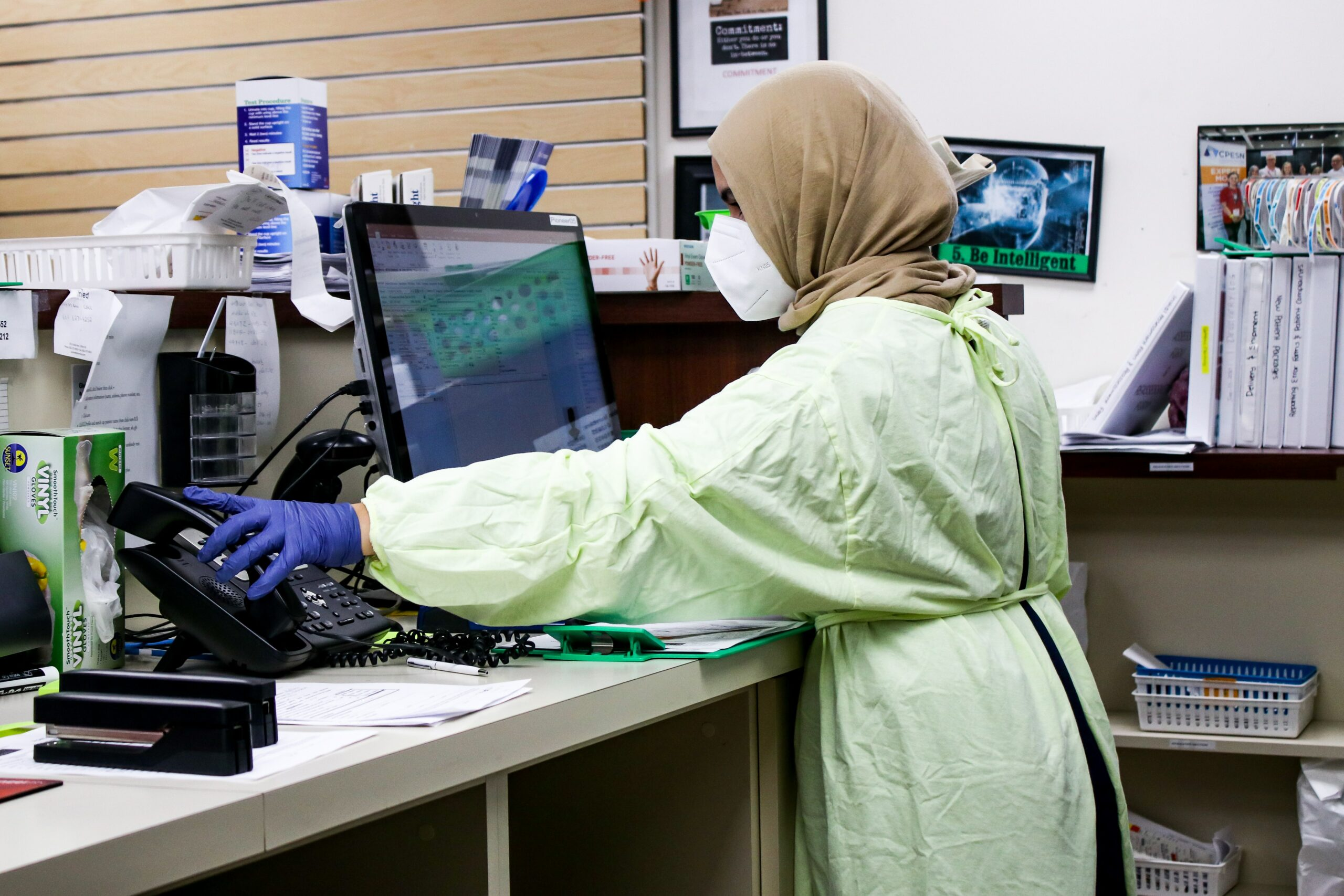 Laboratory technician in front of computer