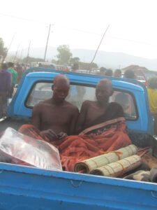 Two boys on the back of a truck having experienced initiation