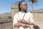 Thandukuthula Khambule, known as PIMPDLOZI, describes himself as a traditional healer who moves with the times.